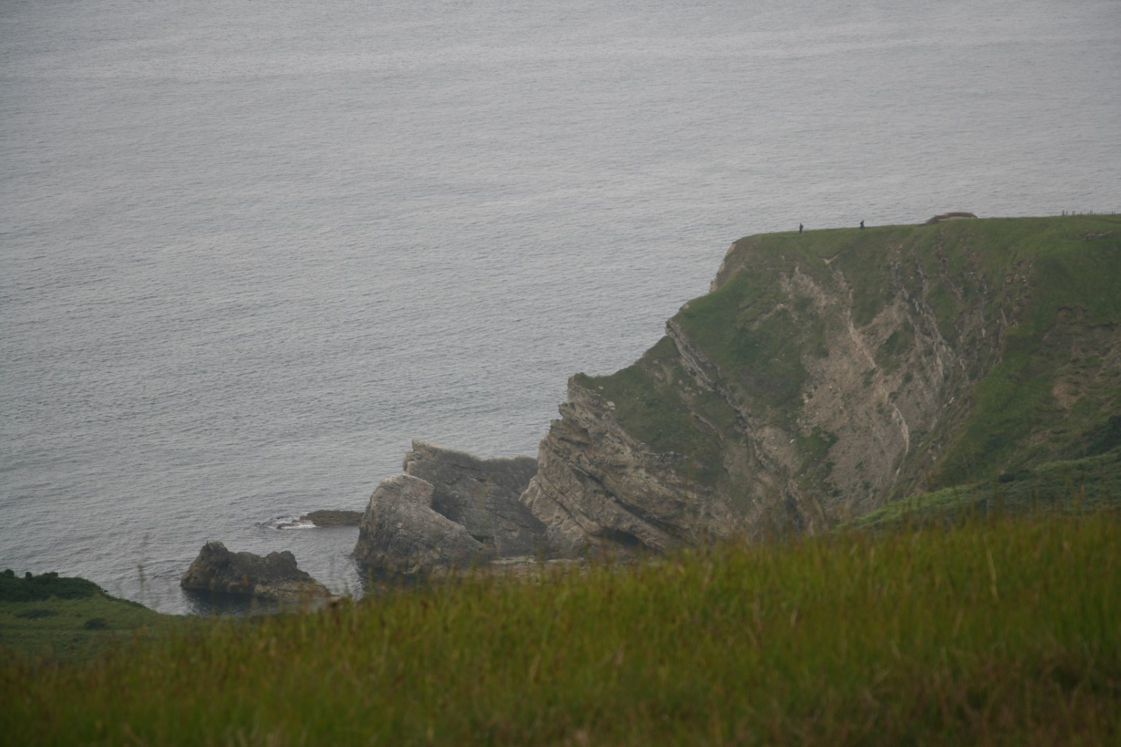 People in the distance to show the scale of the cliffs.