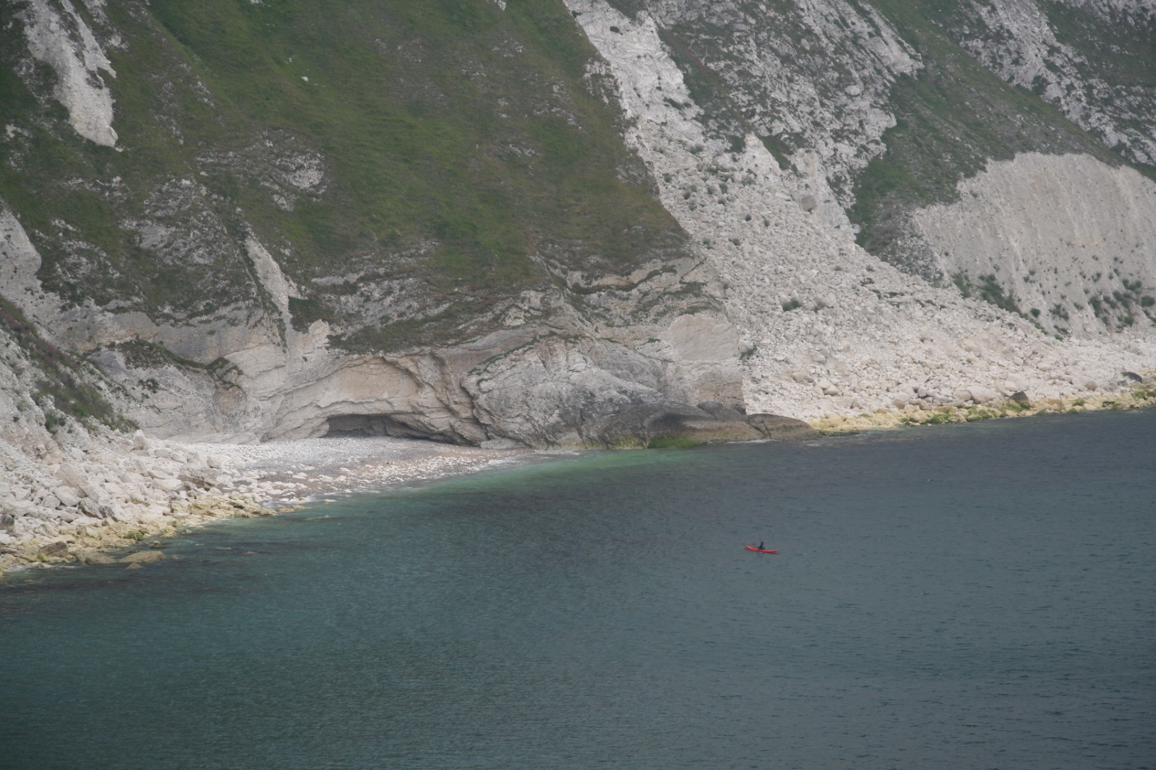 This kayaker shows the scale of the cliffs.